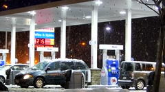 Mobil Gas Station, winter snowstorm snowflakes - stock footage