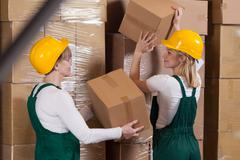 Female workers are preparing orders for export - stock photo