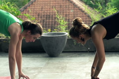 Girlfriends exercising yoga at terrace, slow motion, shot at 120 fps NTSC Stock Footage