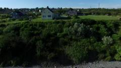 Aerial over cute maritime homes on the coast in Canada. Stock Footage