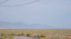 Powerlines and mountains panning shot Stock Footage