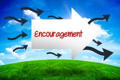 Encouragement against green hill under blue sky Kuvituskuvat