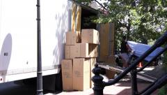 Two movers loading a van Stock Footage