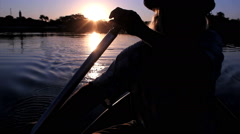 Man in a boat rowing. Beautiful river. Brazilian forest. - stock footage