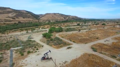 Aerial video of a railroad and oil field 4 - stock footage