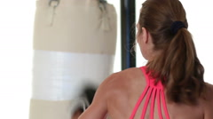 Woman Punching Heavybag Stock Footage