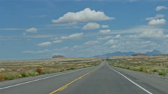 POV-Driving US 550 north New Mexico empty road morning blue sky Stock Footage