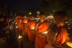 A monk, Asalha Puja Day - JULY 30 : Asalha Puja Day, Buddhist monk walk with - stock photo