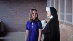 1971: Catholic nun blessing young girl before she travels away. Stock Footage
