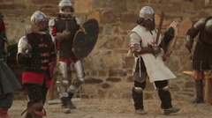battle of knights in armor on the battlefield - stock footage
