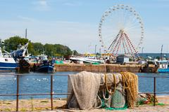 Overlooking the fishing port of Honfleur with fishnets and Ferris wheel Stock Photos