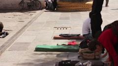 Buddhist pilgrims praying in Lhasa, Tibet Stock Footage