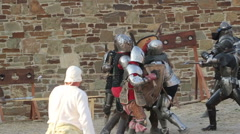 Knights in armor fighting in the fortress - stock footage