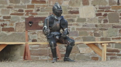 Knights in armor resting in a fortress Stock Footage