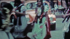 1974: Traditional native dancing on city square for holiday event. Stock Footage