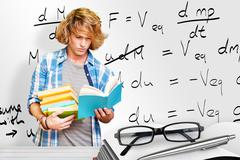Composite image of student reading - stock photo