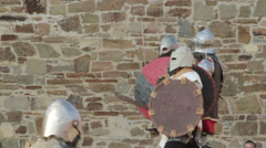 beginning of the battle of knights in armor in the castle during the day - stock footage