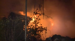 Fire Fighters dampening down fire Stock Footage