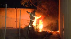 Fire Fighter accessing fire Stock Footage