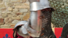 A fight between two knights in armor day Stock Footage