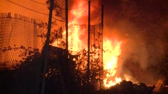 Flames issue near fence Stock Footage