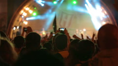 A huge crowd at a rock concert. Fans waving their hands. - stock footage