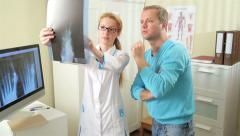 Female doctor Shows Patient His Injury On X-Ray. Stock Footage