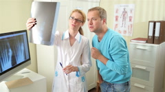 Female doctor Shows Patient His Injury On X-Ray. Arkistovideo
