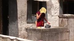 Tibetan monk, cellphone call, Lhasa, Tibet Stock Footage