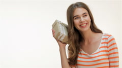 Beautiful woman shaking a gift present - stock footage