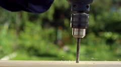 Drilling wooden plank with hand drill Stock Footage