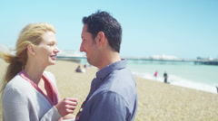 4K Portrait of romantic couple on beach, smiling to camera. Stock Footage