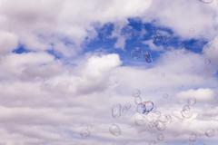 Soap Bubbles Flying In A Gust Of Wind - stock photo