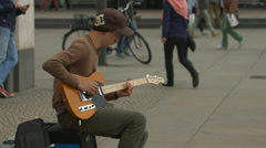 Young man playing an electric guitar in Berlin Stock Footage