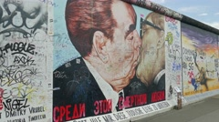 Famous kiss of Brezhnev and Honecker at the Berlin Wall Stock Footage