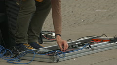 Adjusting an electric guitar pedal board in Berlin Stock Footage