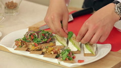 Chef is Making Bruschettas with Vegetable Mix, Pears and Nuts Stock Footage