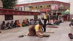 Buddhist pilgrims praying, Lhasa, Tibet Stock Footage