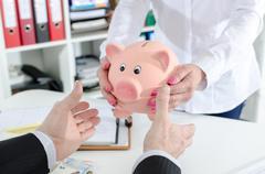 Deposit savings in the bank - stock photo