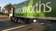 Woolworths truck leaving depot Stock Footage