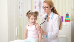 Female Doctor Examining Child With Stethoscope. - stock footage