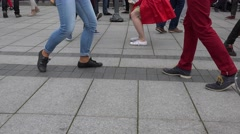 Various pairs dancing cheerful Lindy hop dance on street. 4K Stock Footage