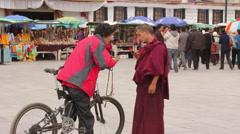 Tibetan Buddhist monk, Barkhor Square, Tibet Stock Footage