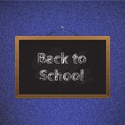 Stock Illustration of Black chalkboard over jeans back to school