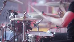 Concert rock band performing on stage. Close up of hands drummer with drum stick Stock Footage