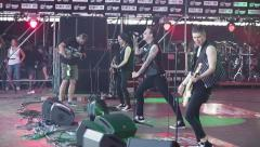 Punk rock band performs on stage Stock Footage