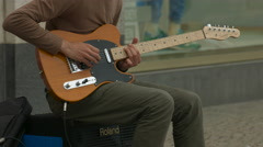 Playing an orange electric guitar in Berlin Stock Footage