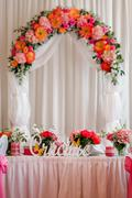 Wedding arch and wedding banquet table in a restaurant - stock photo