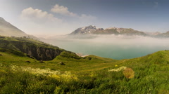 Lac de Mont Cenis artificial lake fog rising in the morning 4K Stock Footage