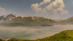 Alpine landscape fog rising over Lac du Mont Cenis lake summer time lapse  Stock Footage